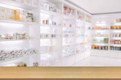 Blurry medicine cabinet and store medicine and pharmacy drugstor. E for background with Perspective wood Royalty Free Stock Images