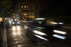 Blurry motion image of cars in traffic stock photo
