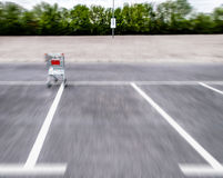 Blurry motion shopping carts on a empty parking lot Royalty Free Stock Image