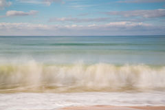 Blurry motion of waves splashing. On the beach Royalty Free Stock Image