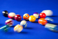 Blurry and moving of billiard balls in a pool table Royalty Free Stock Photography