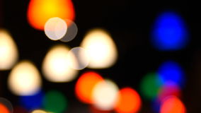 Blurry multicolor lights in a black background. stock footage