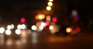 Blurry night shot of city traffic. Defocused cars of commuters. Is going home in the night stock video footage