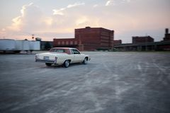 Blurry vintage car drifting in industrial depot Stock Images