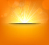 Blurry orange background with lens flare Stock Photos