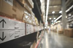 Blurry, out of photo of Perspective and depth of field of Large hangar warehouse industrial and logistics companies. Warehousing on the floor and called the stock photo