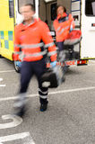 Blurry paramedics getting out from ambulance car. Paramedics jumping out from ambulance car in emergency situation stock photo