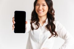 Blurry photo of smiling asian woman with long dark hair standing royalty free stock photo