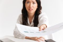 Blurry photo of tense asian woman employee with long dark hair h royalty free stock photography