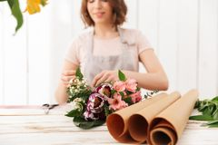 Blurry photo of young florist woman collecting bouquet of differ royalty free stock images