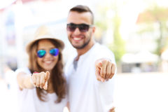 Blurry portrait of a couple pointing to the camera Royalty Free Stock Image