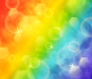 Blurry rainbow background. Abstract vector illustration of blurry rainbow colored background with bokeh and lights Stock Image