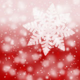 Blurry red snowflake background Stock Photo
