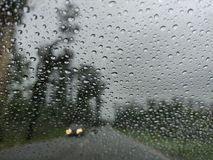Blurry view of countryside road bad weather. stock photography