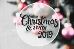 Blurry Rose Balls, Calligraphy Merry Christmas And Happy 2019 stock images