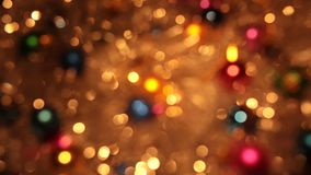 Blurry, the rotation of Christmas balls and golden tinsel. Christmas and New Year stock footage