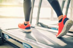 Blurry of  running sport shoes at the gym while a young caucasia Stock Photos