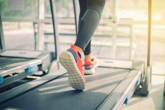 Blurry of  running sport shoes at the gym while a young caucasia Royalty Free Stock Photos