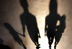 Blurry shadows of family with children stock image