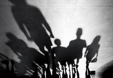 Blurry shadows of people walking. Blurry shadows silhouette of people walking towards the camera on black and white Royalty Free Stock Images