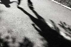 Blurry shadows of rollerskates royalty free stock photo
