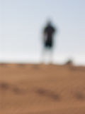 Blurry silhouette. Blurry man silhouette in desert stock image