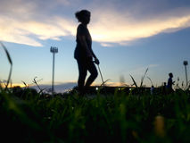 Blurry Silhouette of starting blocks in field. stock images
