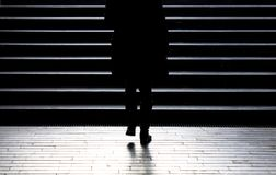 Blurry silhouette of young woman climbing up the city street sta. Urban night walk : Blurry silhouette of young woman climbing up the city street public stairs stock image