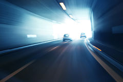 Blurry silver blue color tunnel high speed car driving. Motion blur visualizies the speed and dynamics royalty free stock photos