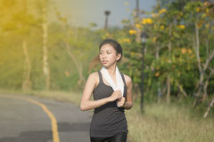Blurry and soft focus of Running woman. Female runner jogging du Stock Photo