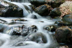 Blurry soft little water fall. At Ancient Siam Royalty Free Stock Photo