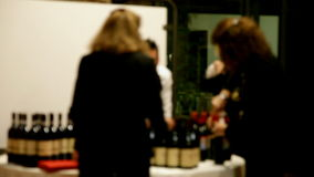 Blurry sommeliers at work. Sommeliers at work. (Out of focus stock video footage