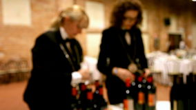 Blurry sommeliers at work. stock footage