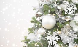 Blurry sparkling Christmas background and decorated fir tree with copyspace Royalty Free Stock Photo