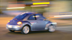 Blurry speeding car at night Stock Photos