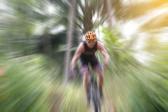 Blurry of Sport. Mountain Bike cyclist riding single track and C. Yclist riding a bike on an off road to the sunset Stock Image