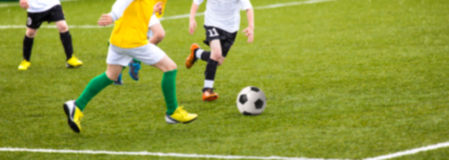 Blurry sport soccer bacground wallpaper. Sport football soccer bacground wallpaper presenting soccer players in a game Royalty Free Stock Photo