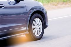 Blurry of sport utility vehicle suv wheel rotating with runnin royalty free stock photo