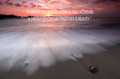 Blurry sunset on the beach with Inspirational quote - A dream you dream alone is only a dream , A dream you dream together is real Stock Image