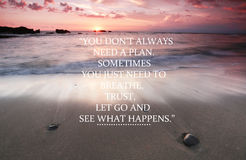Blurry sunset on the beach with Inspirational quote - You don`t always need a plan you just need to breathe, trust, let go and see Stock Images