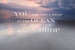 Blurry sunset on the beach with Inspirational quote You are not a drop in the ocean you are entire ocean in a drop. Blurry sunset on the beach with Inspirational stock image
