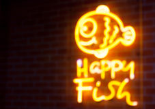 Blurry text fish neon light on wall Royalty Free Stock Image