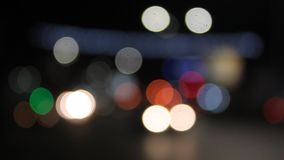 Blurry traffic lights. In the night - bokeh effect stock video footage