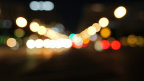 Blurry traffic at night in a city center. Video of blurry traffic at night in a city center stock video footage