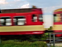 Blurry train. A motion-blurred view of a train passing a grade crossing Royalty Free Stock Photos
