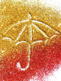 Blurry umbrella of golden and red glitter sparkle on white background Royalty Free Stock Photos