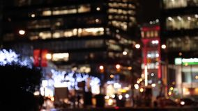 Blurry Vancouver downtown traffic. Out of focus urban traffic Christmas lights stock footage