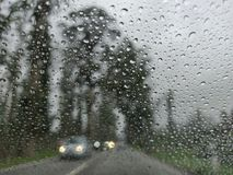 Blurry view of countryside road bad weather. royalty free stock photo