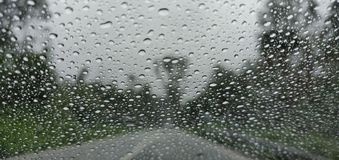 Blurry view of countryside road bad weather. stock photos