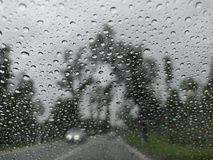 Blurry view of countryside road bad weather. stock photo